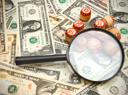 enlarger: Magnifiers and lotto on money. Stock Photo