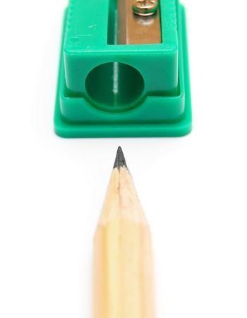 sharpenings: Sharpener and pencil on a white background.