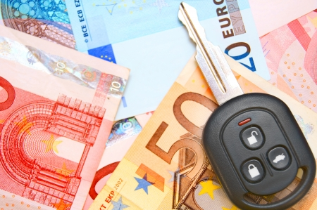 Keys from car on euro banknotes. Stock Photo