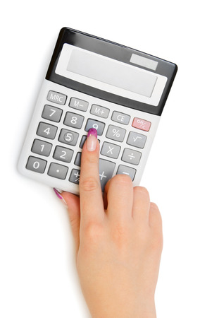 The calculator and hand. On a white background. photo