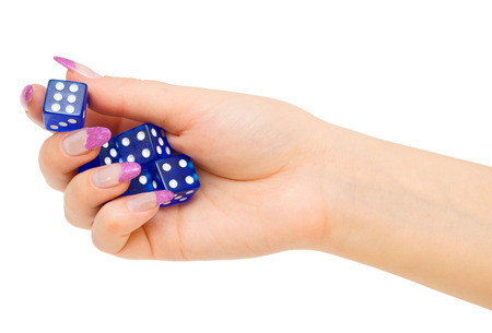 Dices in a hand. On a white background. photo