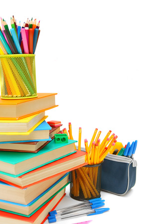 Books and school accessories. On a white background. Stock Photo