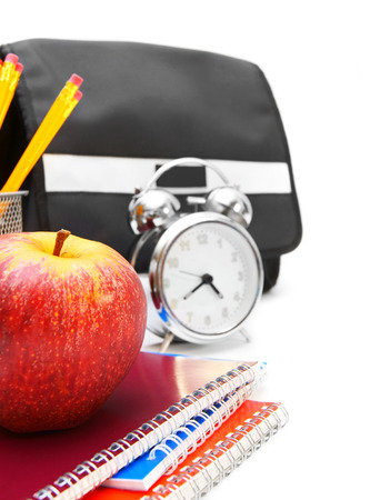 School bag, an alarm clock and other school accessories photo