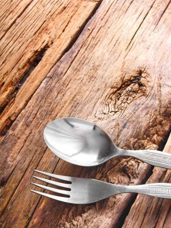 Spoon and fork on wood. photo