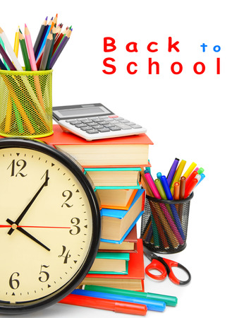 Back to school. Watch and other school subjects on a white background. photo