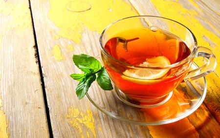 Tea on wooden board . photo