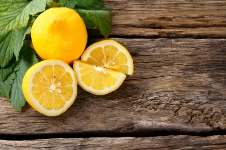 wood cut: Lemons. On a wooden board. Stock Photo