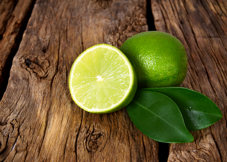 Limes. On a wooden board. photo