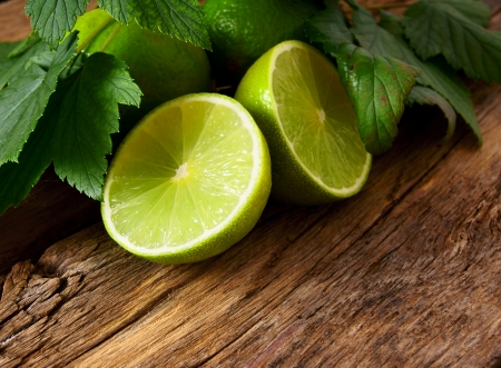 Lime. On a wooden board.