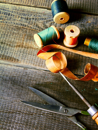Sewing. On a wooden background. photo