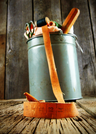 Bucket with tools for sewing. Sewing bucket. photo