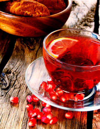 Pomegranate tea with a cookies. photo