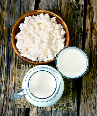 dairy products: Dairy products on a wooden background.