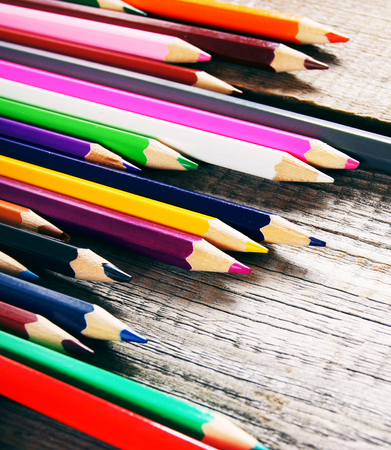 Pencils. On a wooden background. photo