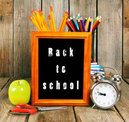 Back to school. School tools on a wooden background. photo