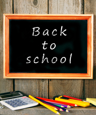 Back to school. School accessories on a wooden background. photo