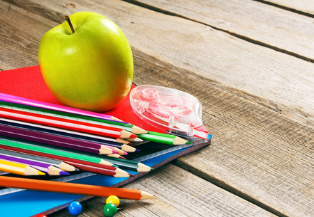School tools. On a wooden background. photo