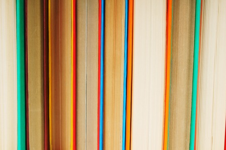 back in an hour: Multi-coloured books. A background from multi-coloured books.