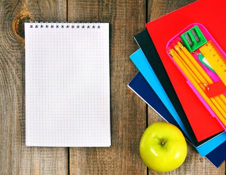 Notebook and school tools around. photo