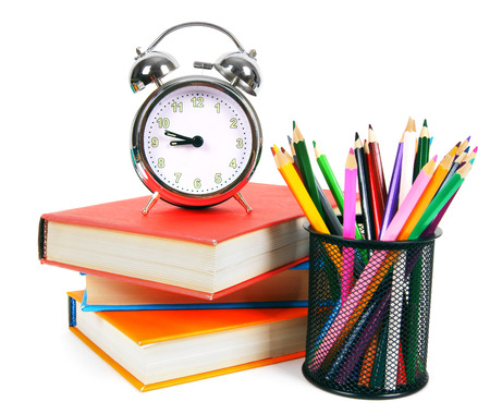 school time: Books, an alarm clock and school tools.