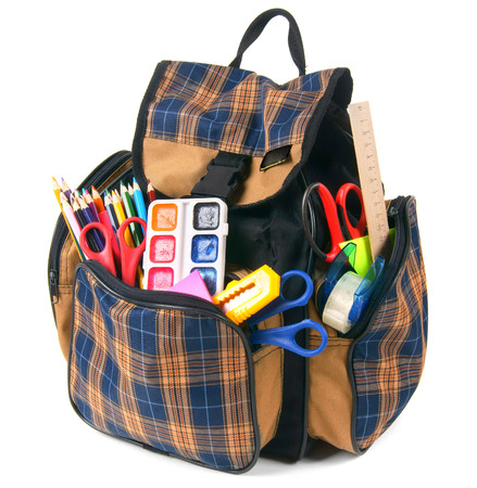School backpack and school tools. On a white background. photo