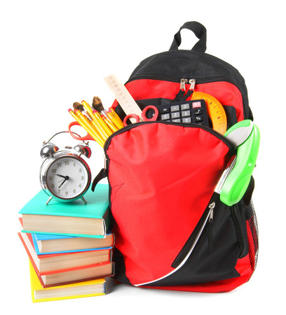 Books, school accessories and a backpack. photo