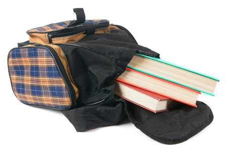 School backpack and books. On a white background. photo