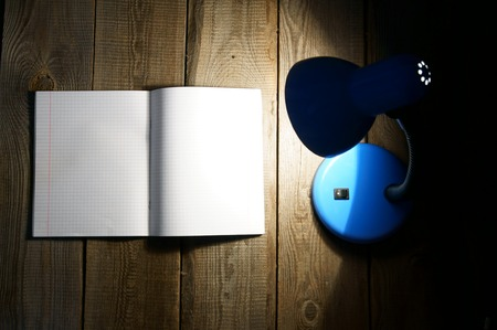 Open writing-book and the fixture. photo