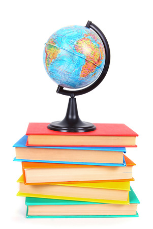 Books and the globe. On white background. photo