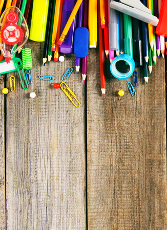 School tools. On wooden background. photo