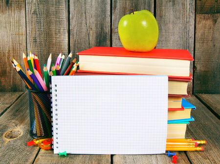 Notebook, books and school tools. photo