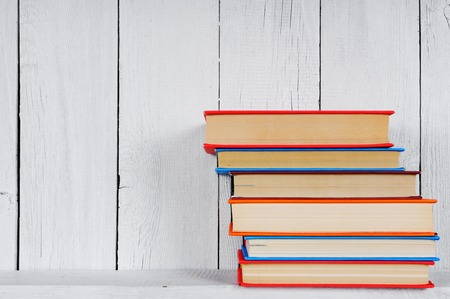 Books on a wooden shelf. photo