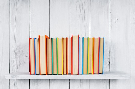 Books on a wooden shelf. Stock Photo
