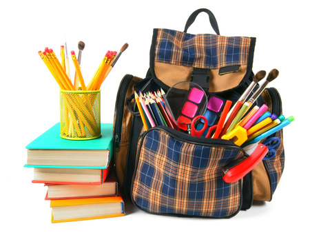 Books, school accessories and a backpack. On a white background. photo