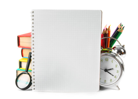 Notebook and school accessories. On a white background. photo
