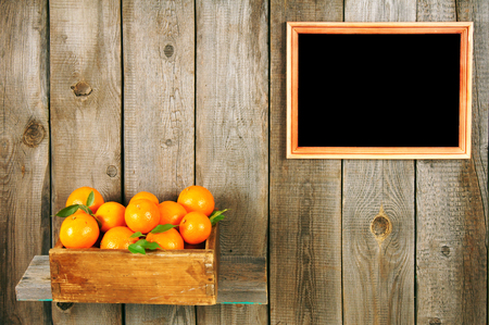 Tangerines in a box photo