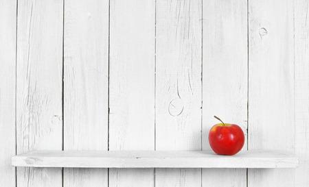 Apple on a wooden shelf. photo