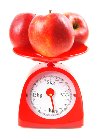 Apples on scales photo