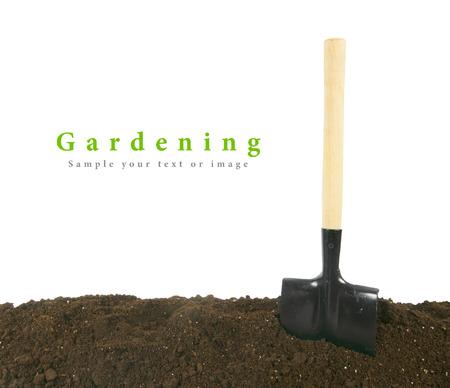 Gardening. A shovel in earth.