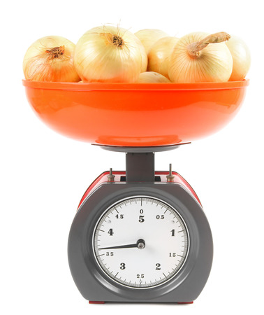 Onions on scales photo