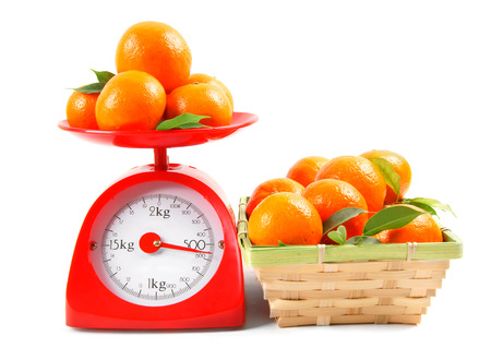 grams: Tangerines on scales and in a basket
