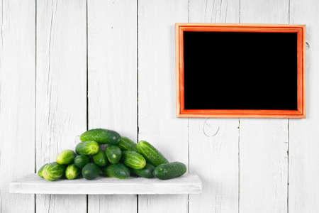 Cucumbers on a wooden shelf. photo