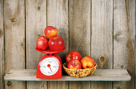 Apples on scales and in basket photo