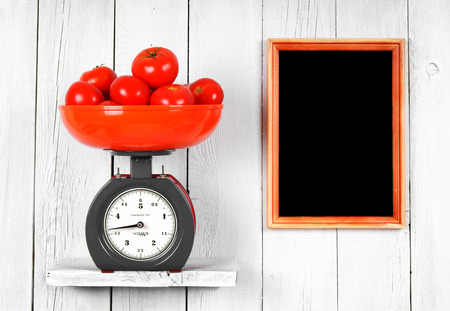 Tomatoes on scales photo