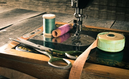 sewing buttons: Sewing. Sewing machine and tools.