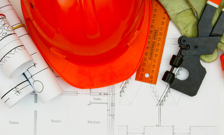 Drawings for building house, helmet and other working tools. photo