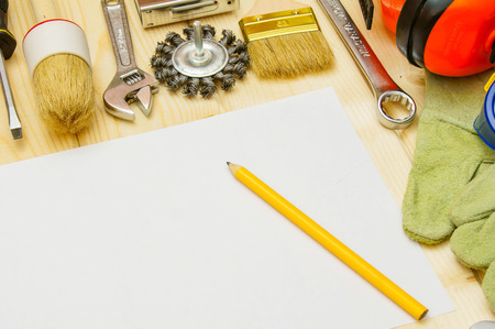 Paper for notes and set of working tools on wooden background. photo
