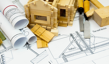 wooden house: Joiners works. Drawings for building, working tools and small wooden house. Stock Photo
