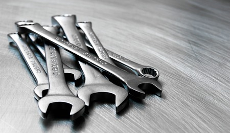 Wrenches on the scratched metal background. 版權商用圖片
