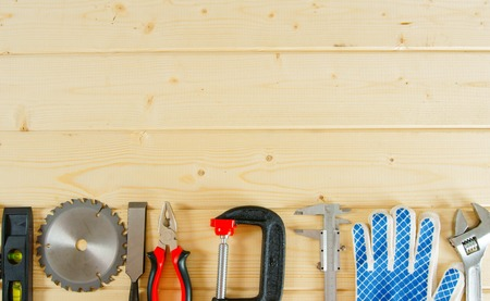 home plans: Many working tools on a wooden background.